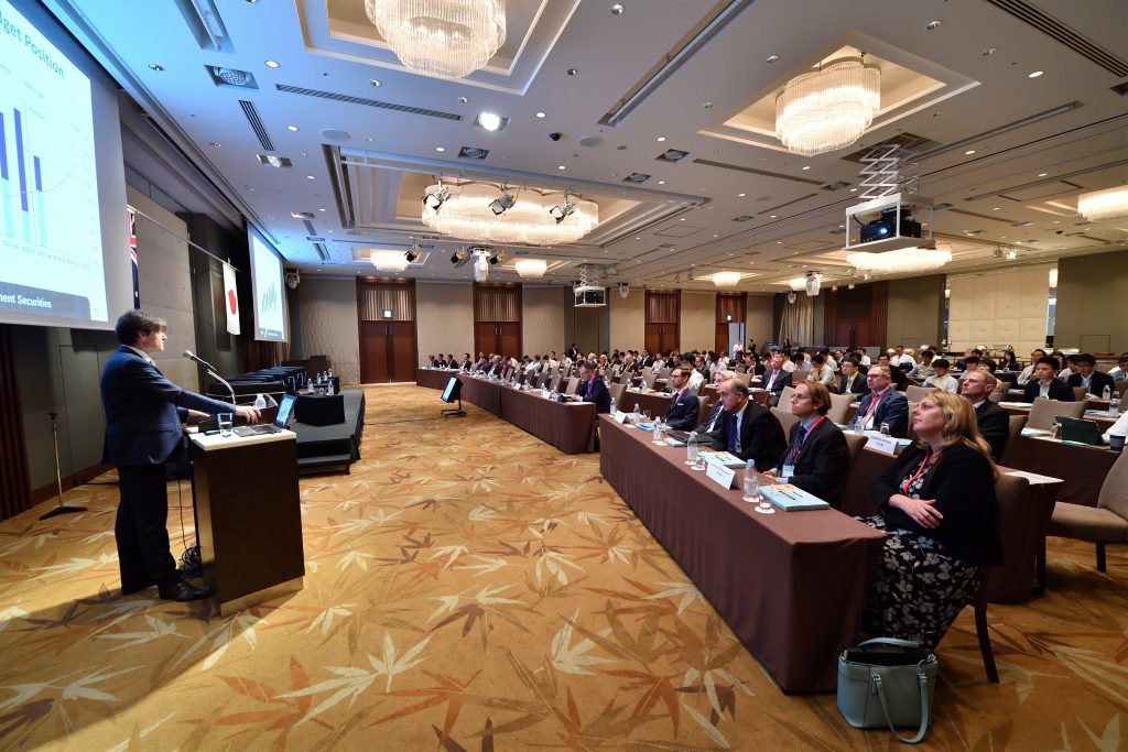 AOFM CEO presenting at a conference in Tokyo